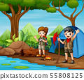 Scout boy and girl in uniform exploring the forest 55808125