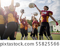 Photo of woman rugby team with raised hands looking at camera 55825566