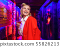 Photo of happy blonde with cocktail in her hand on red and blue background 55826213