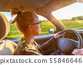 Casual caucasian woman driving passenger car for a journey in countryside. 55846646