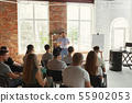 Male speaker giving presentation in hall at university workshop 55902053