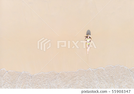 Young woman laying on sand beach 55908347