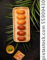 Nigiri sushi set with salmon and tuna served on bamboo plate 55909430
