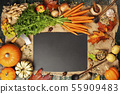 Healthy food cooking background. Fresh garden carrots, pumpkins, onions, apples and spices on rustic 55909483