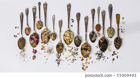 Assortment of dry tea in vintage spoons 55909493