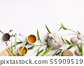 Asian food background set with green tea, cups and teapot with bamboo branches 55909519