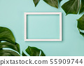 Creative flat lay with tropical plant and white frame for your text 55909744