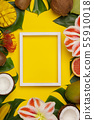 Creative flat lay with tropical fruits and plants and white frame for your text 55910018