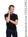 Young security officer talking through his walkie talkie. 55912981