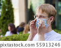 young man with a mask 55913246