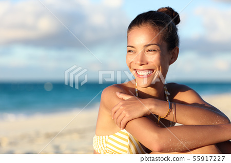 Happy healthy Asian chinese woman smiling on beach 55917227