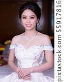 Beautiful Asian bride finished dressing. . 55917816