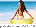 Beach woman relaxing in bikini and cover-up 55918236