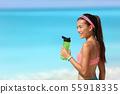 Healthy fitness runner girl drinking water bottle 55918335
