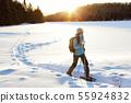 Winter hiking sport activity woman snowshoeing 55924832