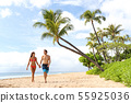 Hawaii holiday couple walking on Maui beach 55925036