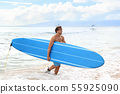 Surfboard man surfer coming out of surfing waves 55925090