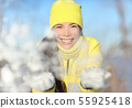 Winter snow fight girl playing throwing snowball 55925418