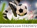 soccer player kicking soccer ball in motion 55925872