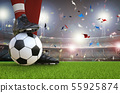 soccer player standing with soccer ball 55925874