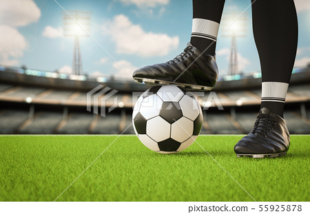 soccer player standing with soccer ball 55925878