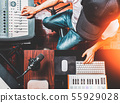 male DJ, producer, composer mixing music in studio 55929028