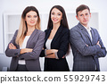 Business and office concept - happy business team in office 55929743
