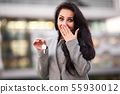 Business, real estate, banking and people concept - smiling business woman with keys over office 55930012