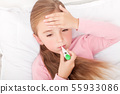 Flu. Young girl lying in bed with a thermometer 55933086