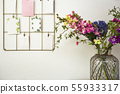 Bouquet of colorful flowers white wall and post cards hanging, modern interior 55933317