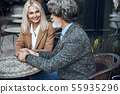 Loving couple holding hands in cafe stock photo 55935296