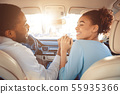 Happy couple holding hands, traveling in car 55935366