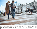 Smiling mature couple crossing the road stock photo 55936210