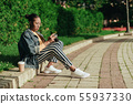 Young afro-american woman using photo camera at city 55937330