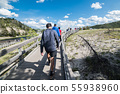 Tourists take a walk on geysers in Yellowstone 55938960