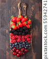 Fresh organic summer berries mix on vintage wooden 55942741