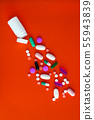 A variety of medicinal pills and pills poured out 55943839