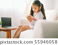 happy child little asian girl  reading a books on 55946058