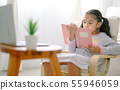 happy child little asian girl  reading a books on 55946059