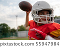 Photo of american football player woman throwing ball 55947984