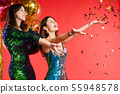 Group smiling woman posing surrounded by colorful 55948578