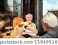 Men celebrating their retirement while drinking alcohol 55949518
