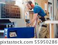 Carpenter working at the circular cutter 55950286