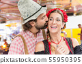 Woman and man on the Oktoberfest in love 55950395