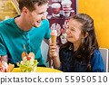 Dad and daughter eating ice cream 55950510