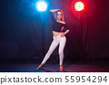 Young woman dancing in the dark, emotions and enjoyment 55954294