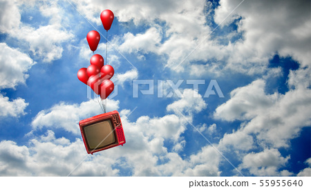 Flying television with red balloons in sky, 55955640