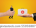 Man's hand exchanging tiny businessman for medical bag held in another man's hand on amber 55956887