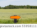 Turn right road sign in a farmers field 55958111