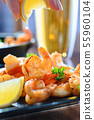 tasty grilled shrimps with lemon juice closeup 55960104